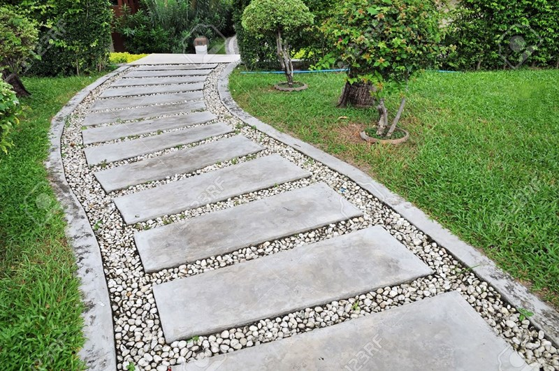14912136-stone-walkway-on-a-grassy-in-the-garden
